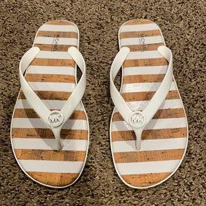 Like new MK flip flops